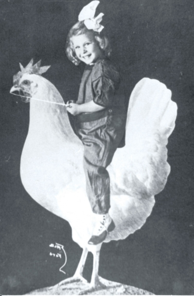 Girl riding a chicken statue