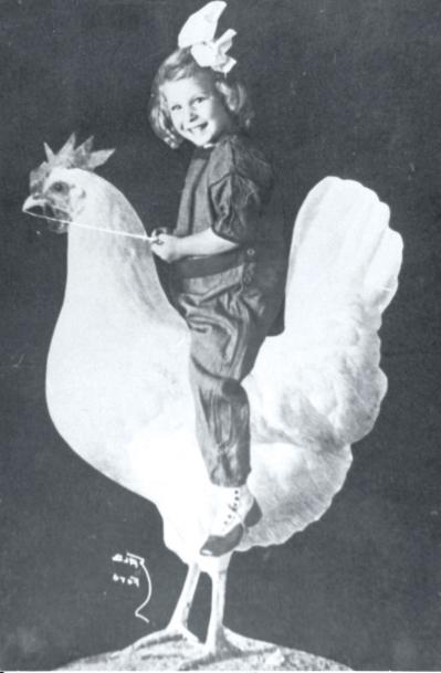 Girl riding a chicken statue