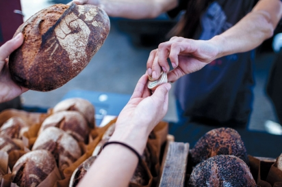 Fresh bread in exchange for incentive tokens at the farmers' market