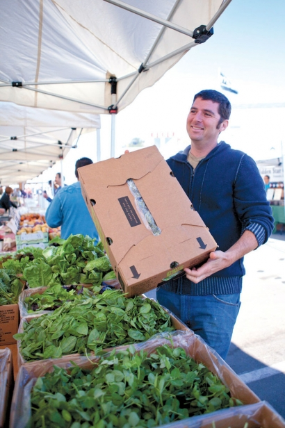 Chef Dan Baker shopping at the farmers market