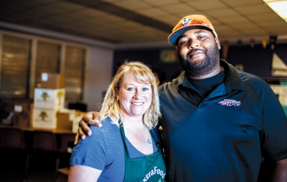 Amy Phillips, a volunteer with Extra Food, and Franklin Smith, the director of the after-school program at Davidson